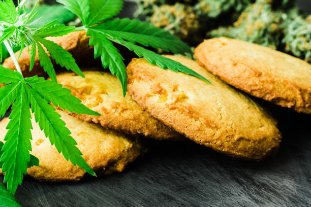 CBD Concept of cooking with cannabis, Cookies with cannabis and buds of marijuana on the table. - foto stock