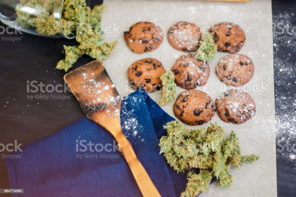 Concept of cooking with cannabis herb Cookies with cannabis and buds of marijuana on the table. royalty-free stock photo