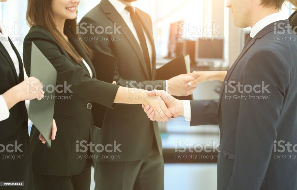 concept of cooperation.handshakes when meeting business partners - foto de acervo