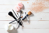 Concept of cosmetics and makeup with powder, skincare and brushes