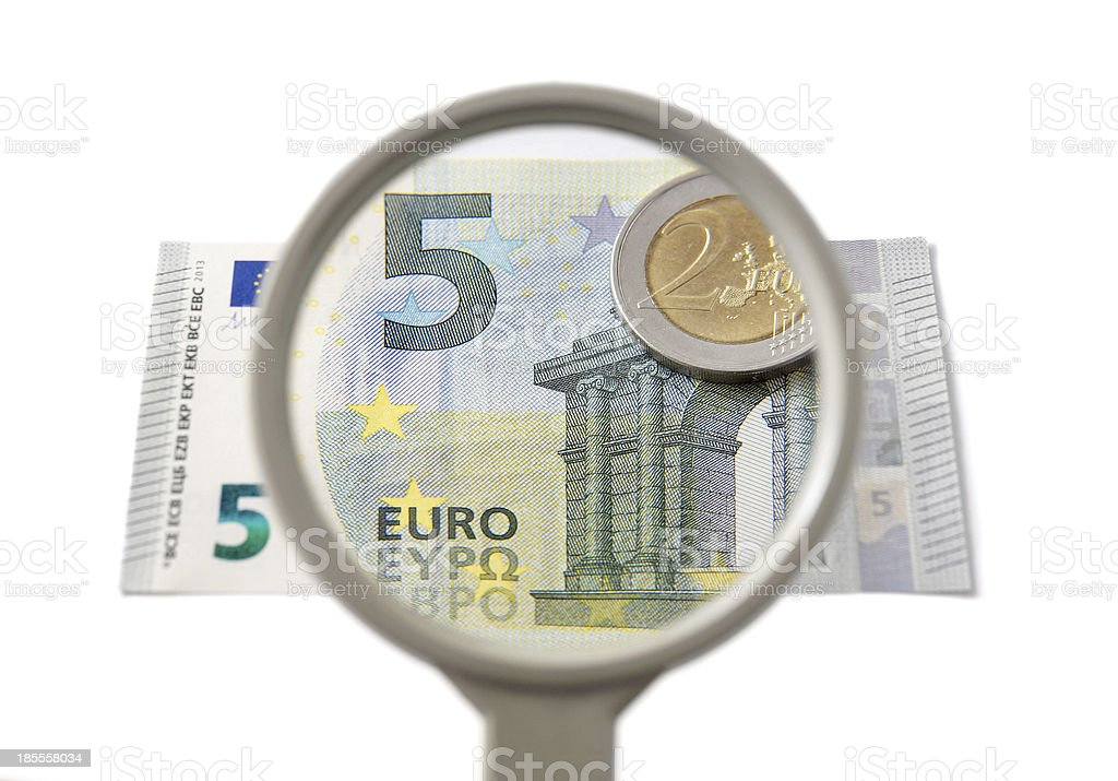 concept of creative accounting with magnifier and money royalty-free stock photo