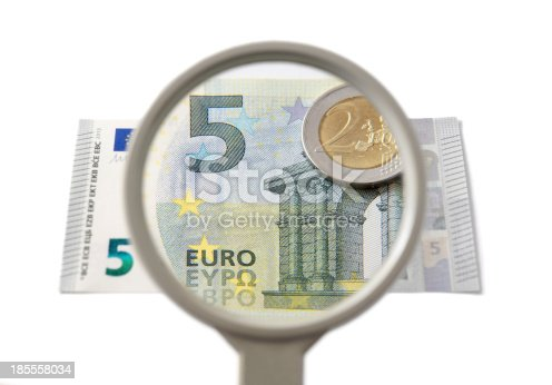 istock concept of creative accounting with magnifier and money 185558034