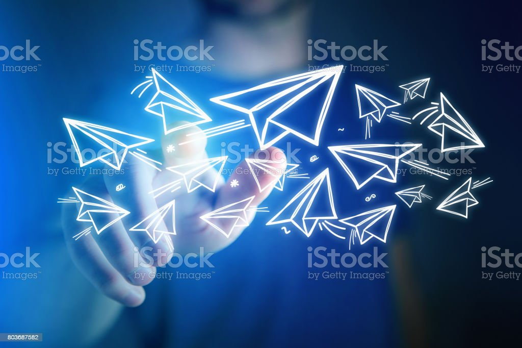 Concept of creativity with flying paper plane over a technology interface stock photo