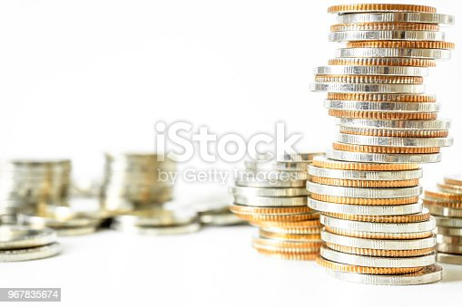 istock Concept of currency trading, making a decision for an optimal gain. Graph and rows of coins for finance and business concept. 967835674