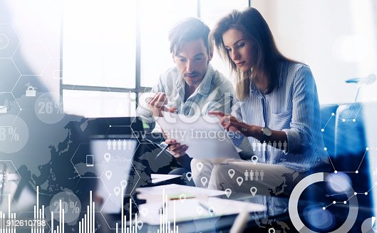 912617272 istock photo Concept of digital diagram,graph interfaces,virtual screen,connections icon.Teamwork.Young business people working with new startup project.Blurred background.Horizontal. 912610798