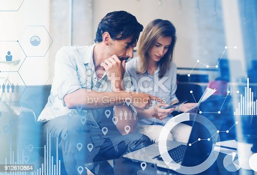 istock Concept of digital diagram,graph interfaces,virtual screen,connections icon.Teamwork process.Young business people working with new startup project.Blurred background.Horizontal. 912610864