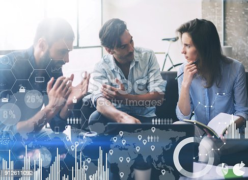 912617272 istock photo Concept of digital diagram,graph interfaces,virtual screen,connections icon.Coworking process in a sunny office.Young people working on laptop and using mobile devices.Horizontal,blurred background. 912611092