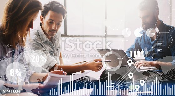 912617272 istock photo Concept of digital diagram,graph interfaces,virtual screen,connections icon on blurred background.Group of three young coworkers working together at modern coworking studio. 912613834