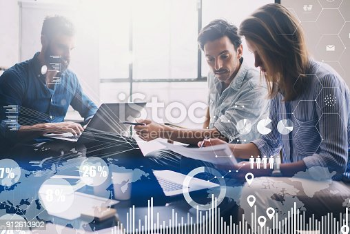 912617272 istock photo Concept of digital diagram,graph interfaces,virtual screen,connections icon on blurred background.Group of three young coworkers working together at modern coworking studio.Horizontal. 912613902