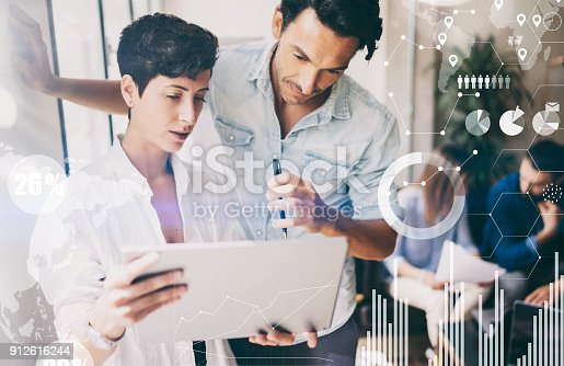 912617272 istock photo Concept of digital diagram,graph interfaces,virtual screen,connections icon on blurred background.Coworking team meeting.Group of colleagues working with startup project in modern office.Cropped. 912616244
