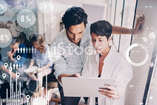 912617272 istock photo Concept of digital diagram,graph interfaces,virtual screen,connections icon on blurred background.Coworking team meeting.Group of colleagues working with startup project in modern office. 912616328