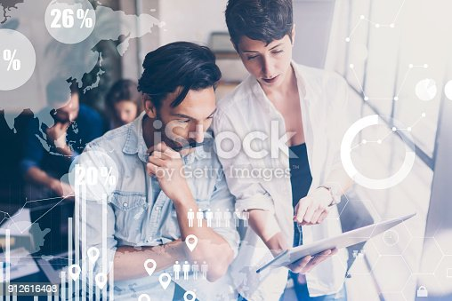 istock Concept of digital diagram,graph interfaces,virtual screen,connections icon on blurred background.Coworking team meeting at modern office.Group of colleagues working with startup project.Cropped. 912616408