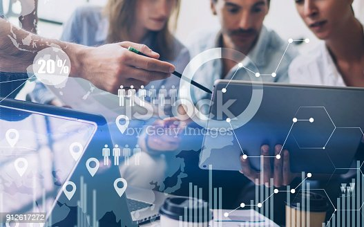 istock Concept of digital diagram,graph interfaces,virtual screen,connections icon on blurred background.Coworking team meeting. 912617272