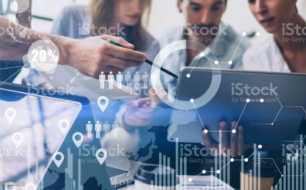 Concept of digital diagram,graph interfaces,virtual screen,connections icon on blurred background.Coworking team meeting. stock photo