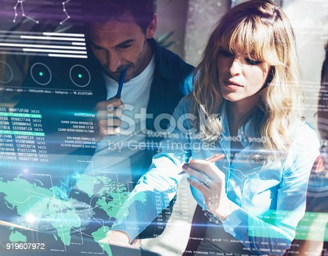 912617272 istock photo Concept of digital diagram,graph interfaces,virtual screen,connections icon on blurred background.Group of two young coworkers working together at modern coworking studio.Horizontal. 919607972