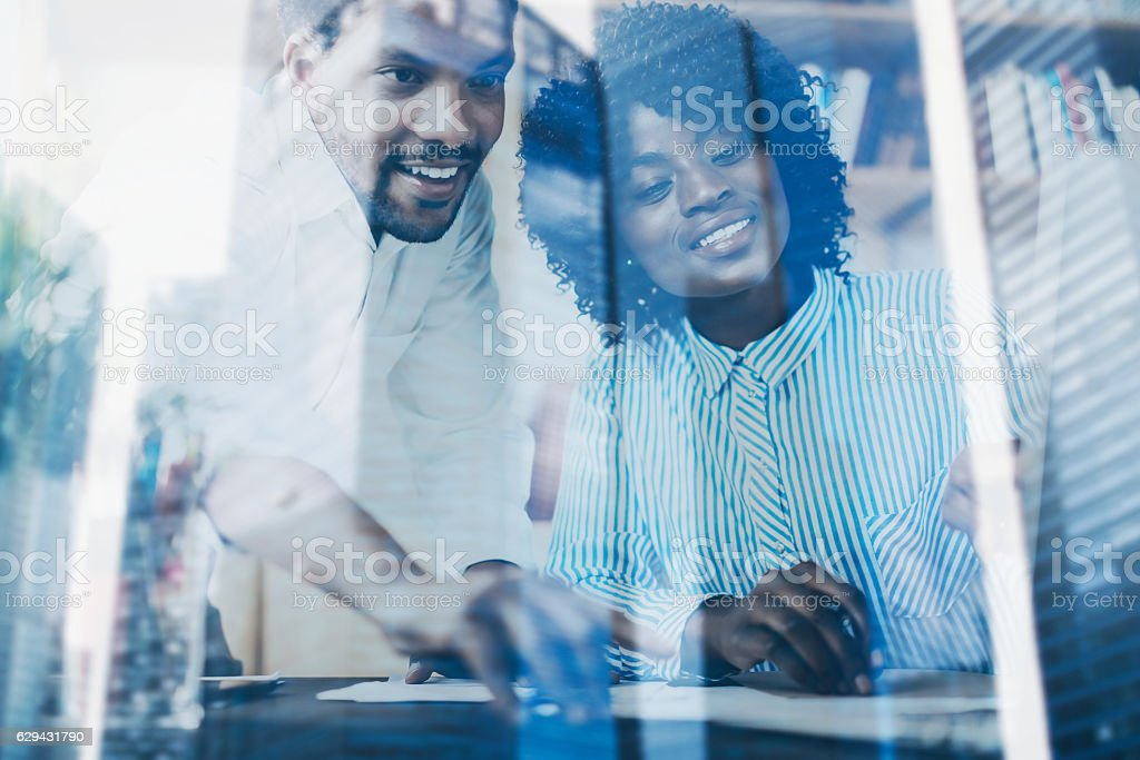 Concept of double exposure.Two young coworkers working together in stock photo