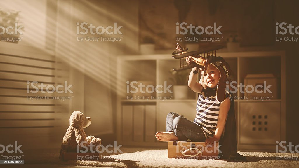 concept of dreams and travels.  pilot aviator child stock photo