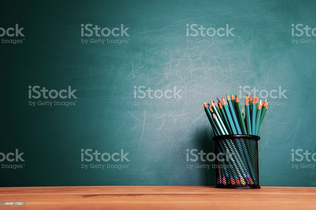 Concept of education or back to school on green background
