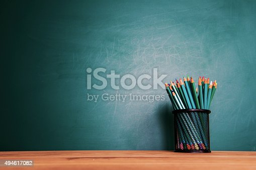 istock Concept of education or back to school on green background 494617082