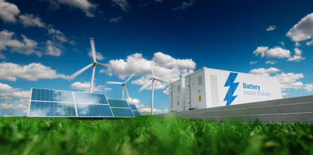concept of energy storage system. renewable energy - photovoltaics, wind turbines and li-ion battery container in fresh nature. 3d rendering. - energia rinnovabile foto e immagini stock