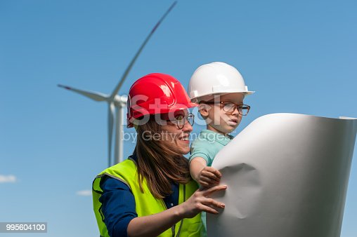 istock Concept of engineers and windmills 995604100