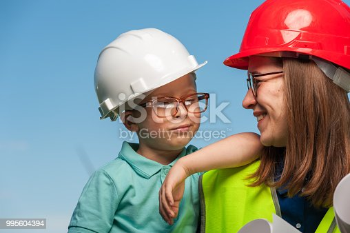 istock Concept of engineers and windmills 995604394
