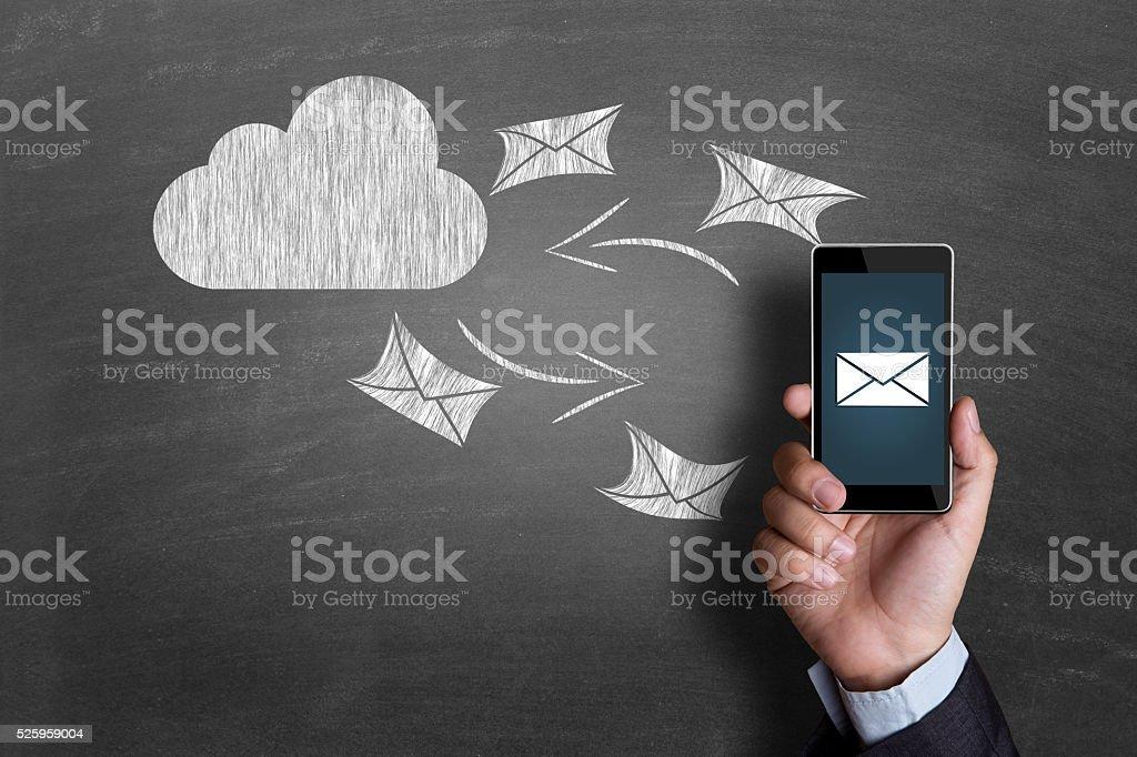 Concept of exchanging e-mail on cloud computing stock photo