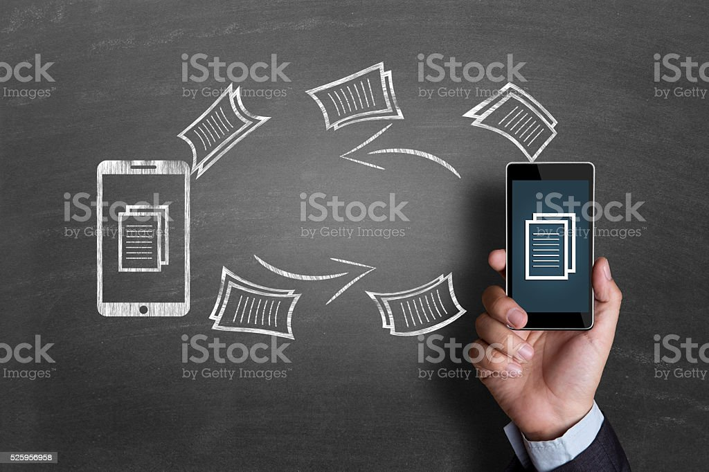 Concept of exchanging files on blackboard stock photo