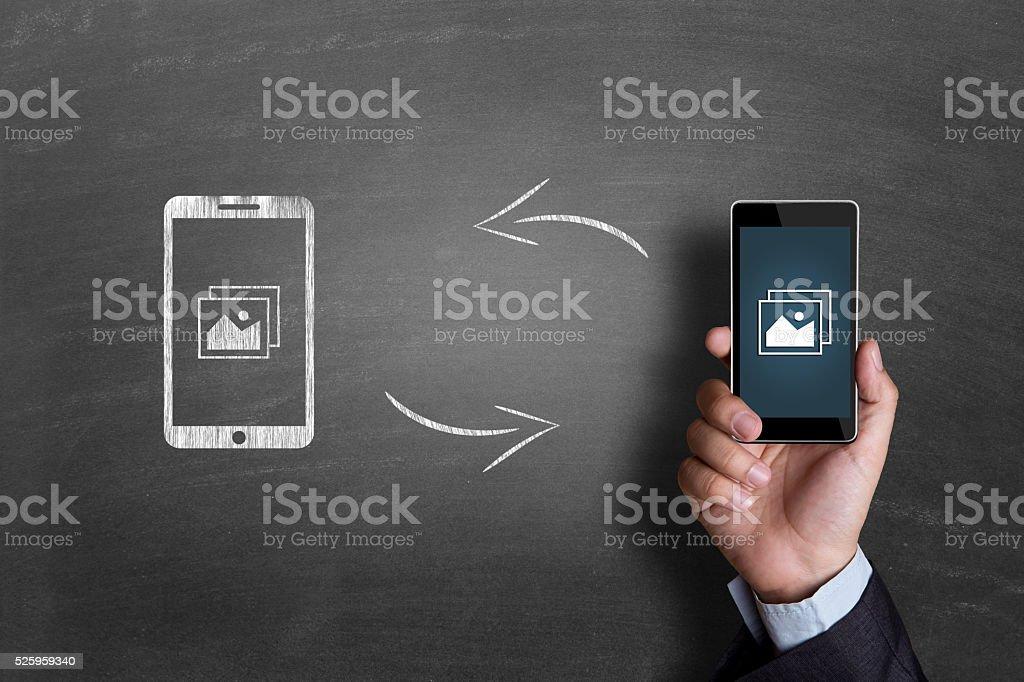 Concept of exchanging image on blackboard stock photo