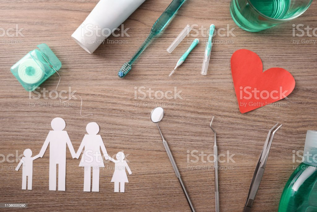 Concept of family dental insurance  on table with representative elements stock photo