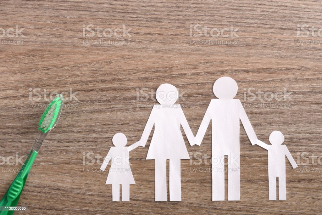 Concept of family dental insurance on wood table top stock photo