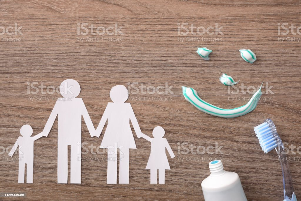 Concept of family dental insurance with representative elements on wood stock photo