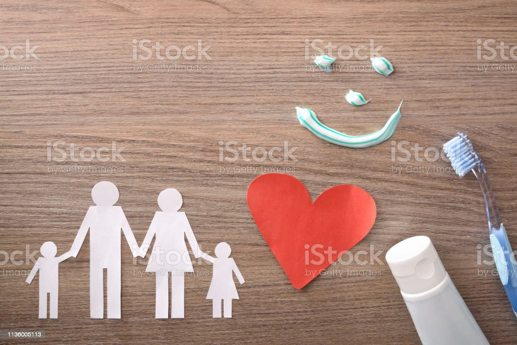 Concept of family dental insurance with representative elements on table stock photo