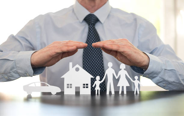Concept of family, home and car insurance stock photo
