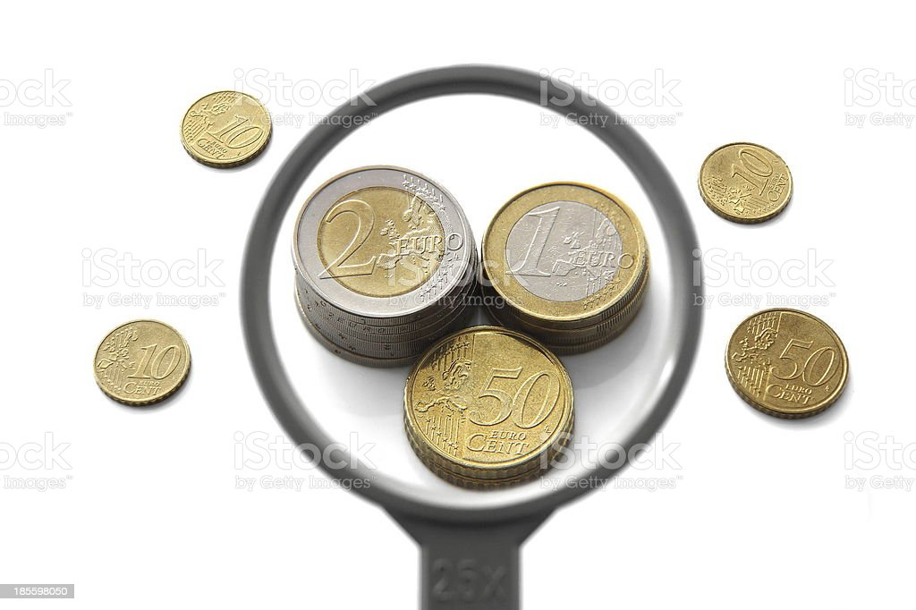 concept of financial balloon with magnifier and money stock photo