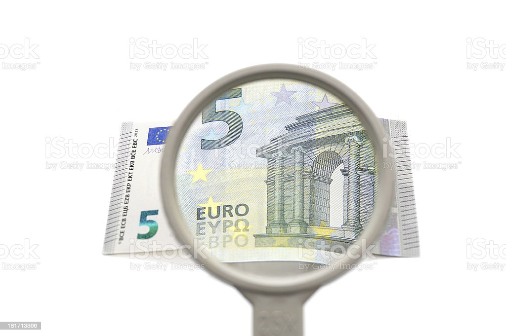 concept of financial investigation with magnifier and money stock photo