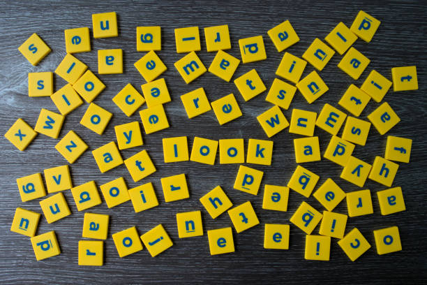 concept of focus or concentration in word look among the blocks of english letters scattered - word game stock pictures, royalty-free photos & images