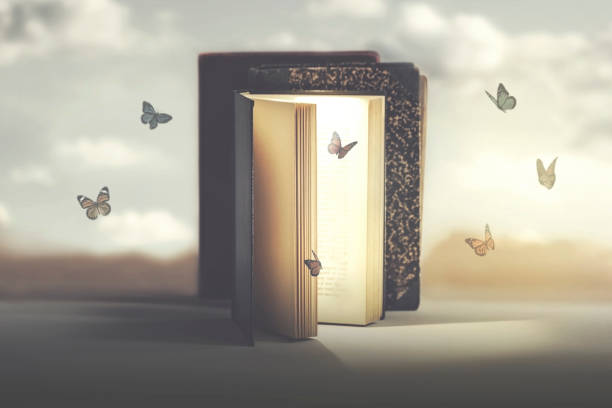 concept of freedom and fantasy of butterflies coming out of a mysterious book stock photo