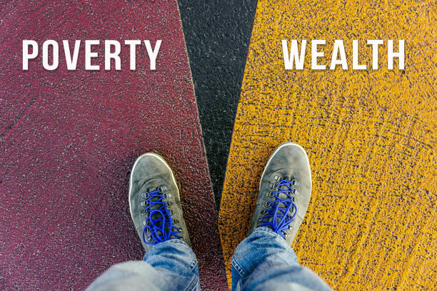 Concept of gap between poor and rich shown by shoes on different colored pathways stock photo