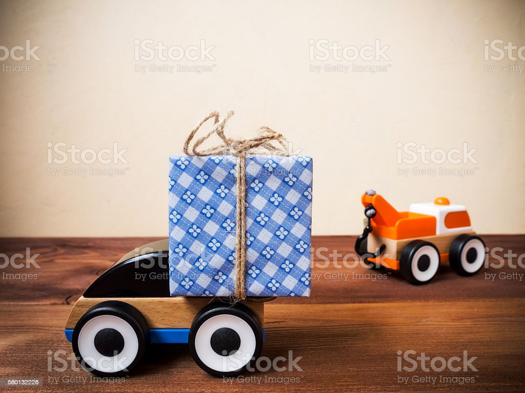 Gift box and toy machinery. Gift delivery service concept. Shallow...