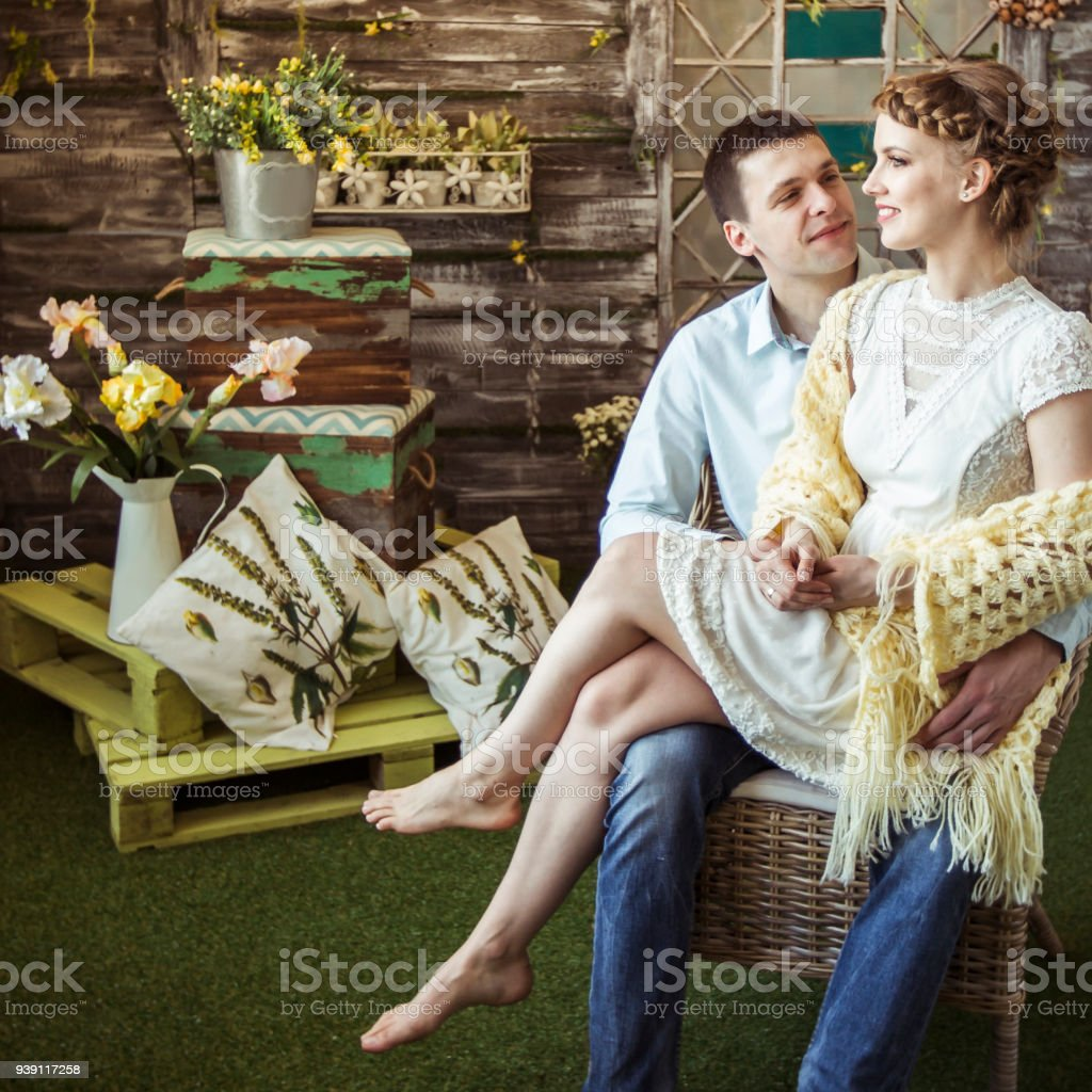 Concept Of Happiness Is A Happy Wife Sitting On The Lap Of