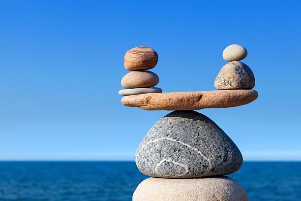 Concept of harmony and balance. Balance stones against the sea. stock photo
