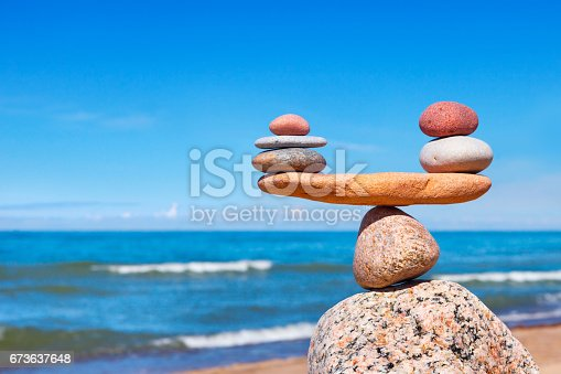 istock Concept of harmony and balance. Balance stones against the sea. 673637648