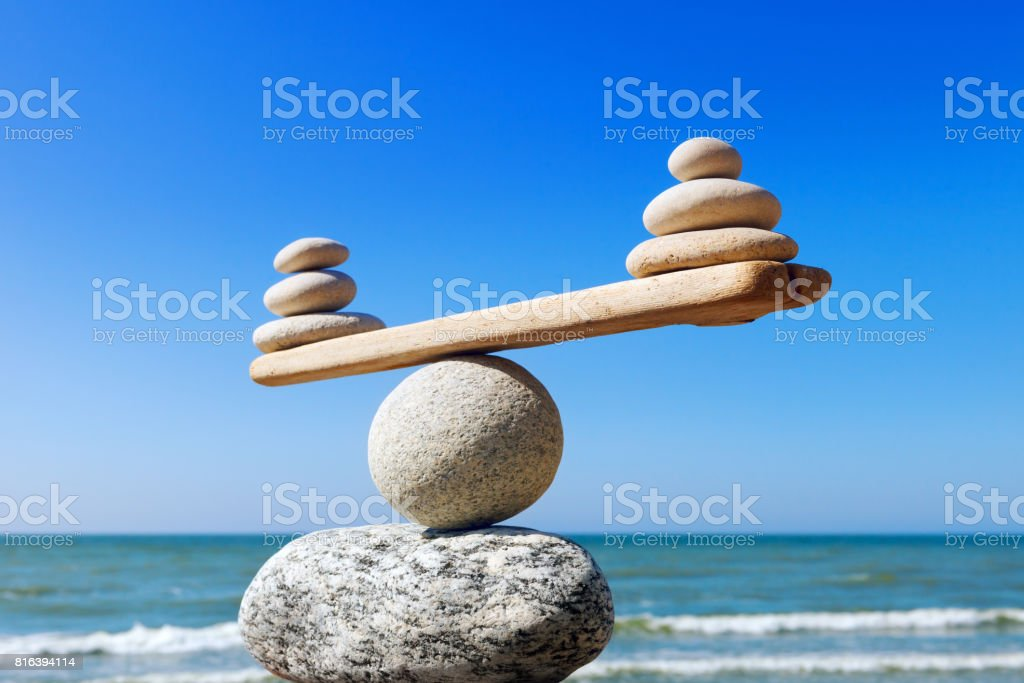 Concept of harmony and balance. Balance stones against the sea. royalty-free stock photo