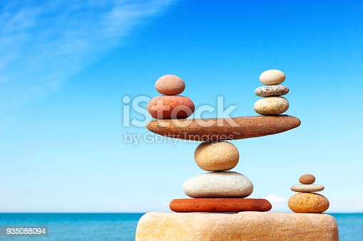 istock Concept of harmony and balance. Balance stones against the sea. 935088094