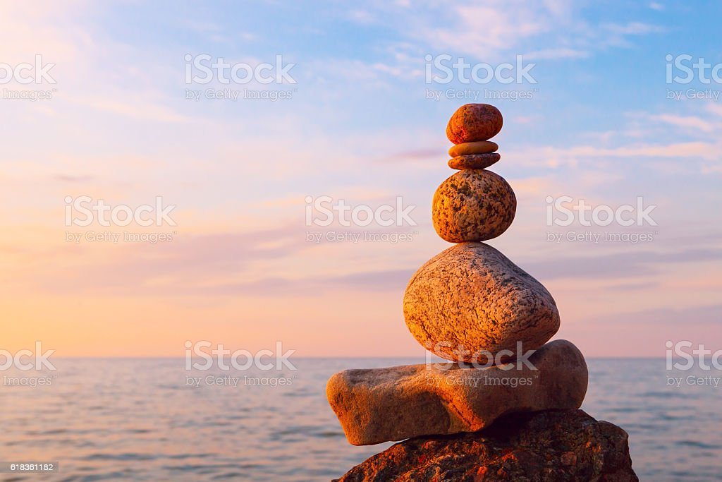 Concept of harmony and balance. Rock Zen at sunset. Balance stock photo