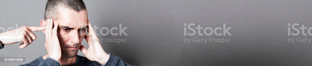 concept of headache, tinnitus, bipolar behavior or male psychiatry, panorama stock photo
