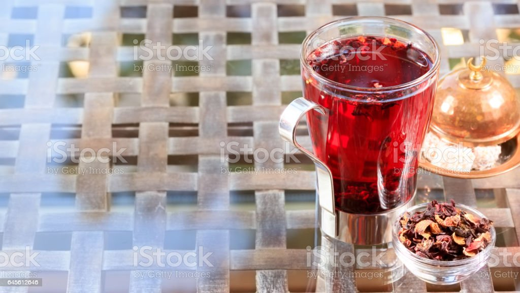 Concept of herbal tea. Hibiscus tea in a glass mug with turkish locum. Healthy caffein-free drink. stock photo