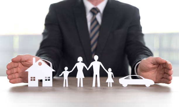 Concept of home, family and car insurance stock photo
