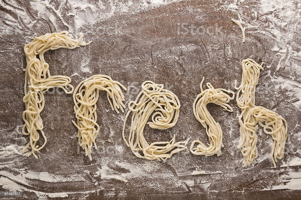 Concept of home-made uncooked pasta  forming the word FRESH royalty-free stock photo